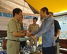 serahterima SK dari Bupati Pinrang H. A. Aslam Patonangi kepada Koordinator Badan Koordinasi Muharijadi Atmomarsono